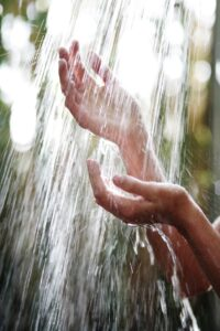 Picture of hands in waterfall of water